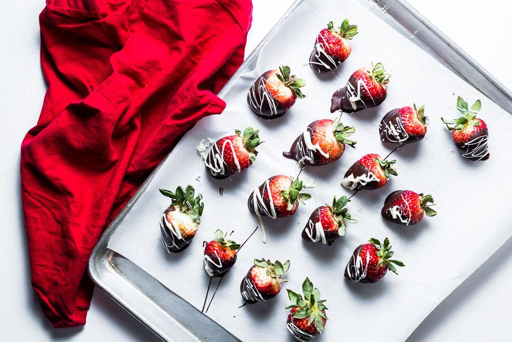 Chocolate-Dipped Strawberries on sheet pan overhead