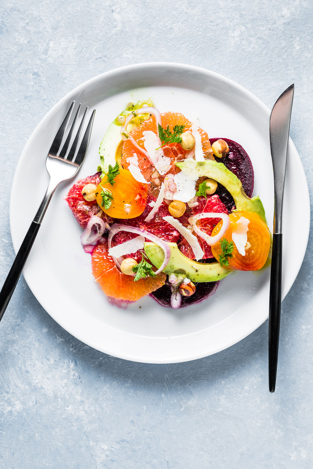Citrus Beet and Avocado Salad with fork and knife