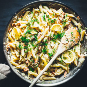 Creamy Lemon Vodka Salmon Pasta in skillet horizontal