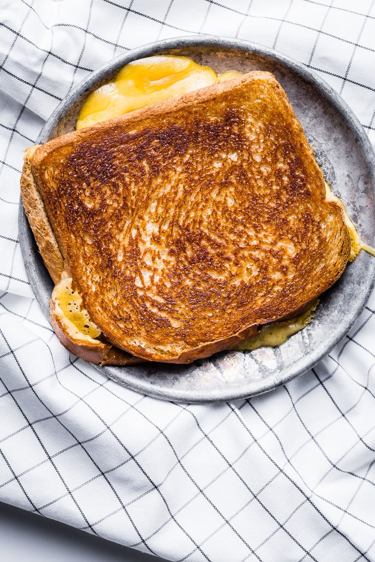 Grilled Cheese on metal plate unsliced