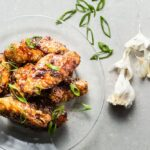 Honey-Garlic Air Fried Chicken Wings hero on glass plate