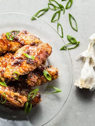 Honey-Garlic Air Fried Chicken Wings hero on glass plate