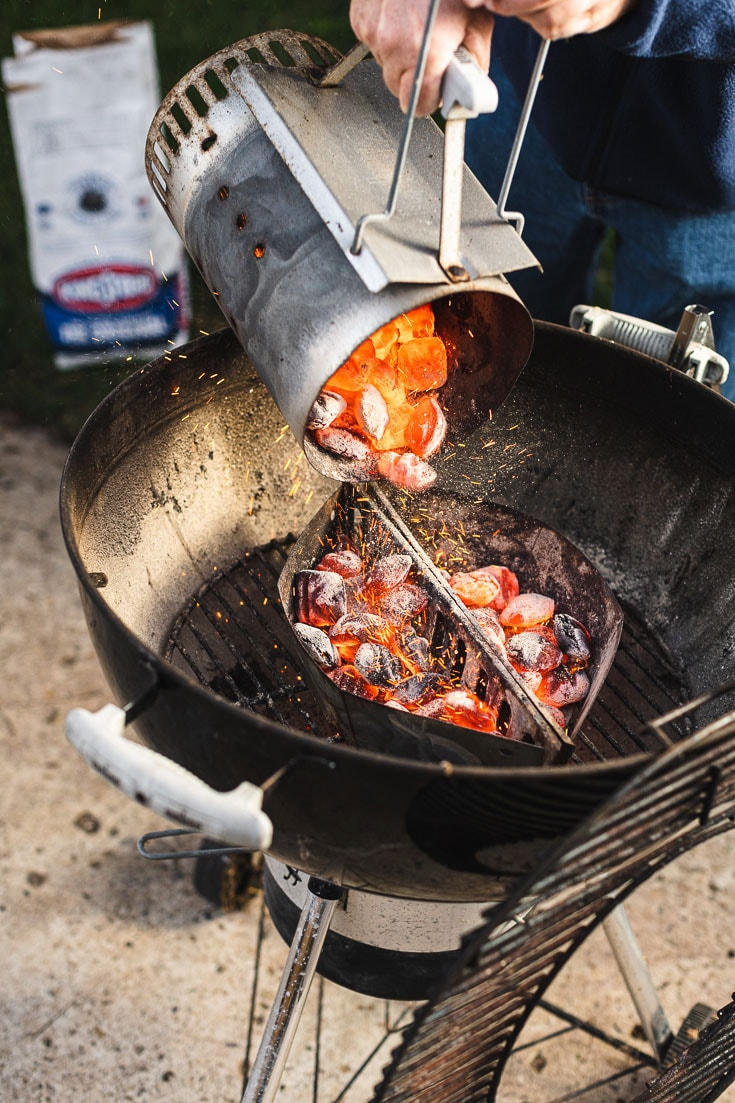 Kingsford Charcoal briquets into the grill