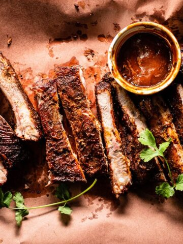 Smoked Sous Vide Ribs on butcher paper with bbq sauce