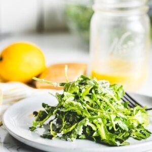 arugula salad with lemon vinaigrette on plate