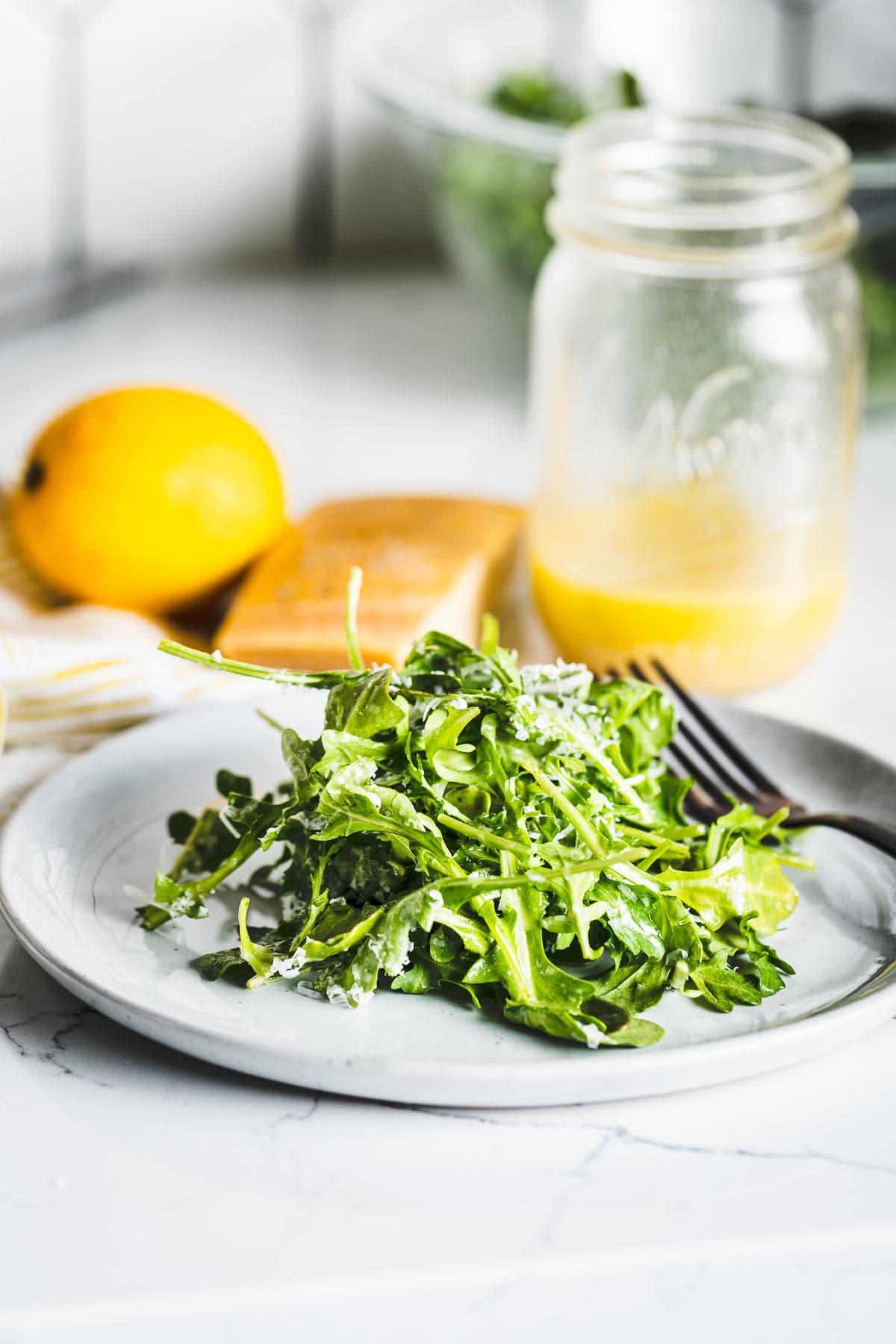 arugula salad with lemon vinaigrette on plate vertical
