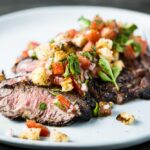 aussie flank steak with breadcrumb salsa closeup horizontal