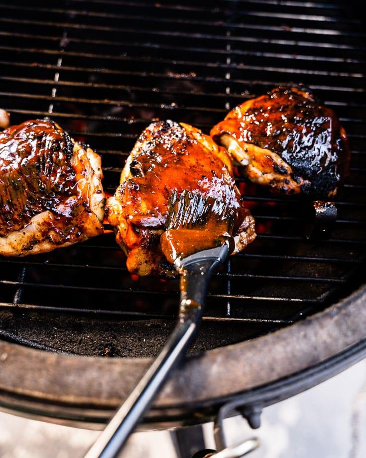 basting sauce on BBQ Chicken Thighs