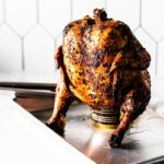 beer can chicken resting on sheet pan