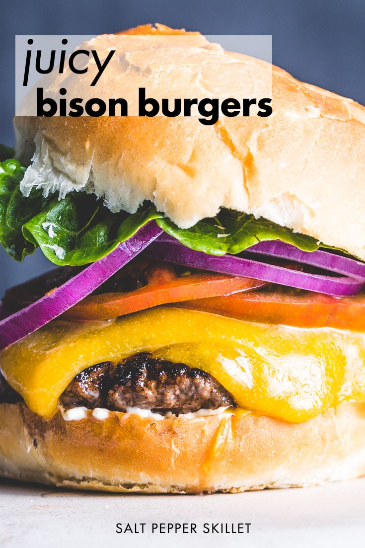 Big, juicy bison burgers are cooked in a cast iron skillet for a delicious crust, covered with melty cheese and your favorite toppings. #bisonburger #bison #burger #saltpepperskillet
