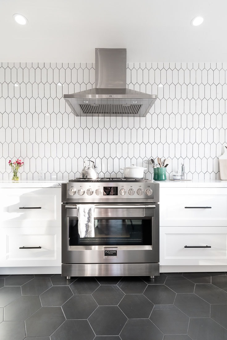 black and white kitchen reveal stove head on