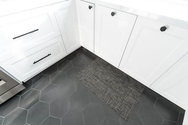 black hex tile floors with white cabinets