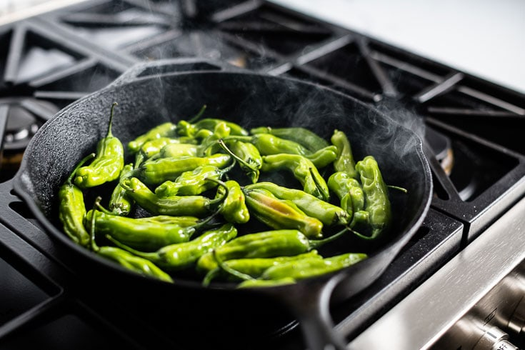 blistered shishito peppers in cast iron skillet 3
