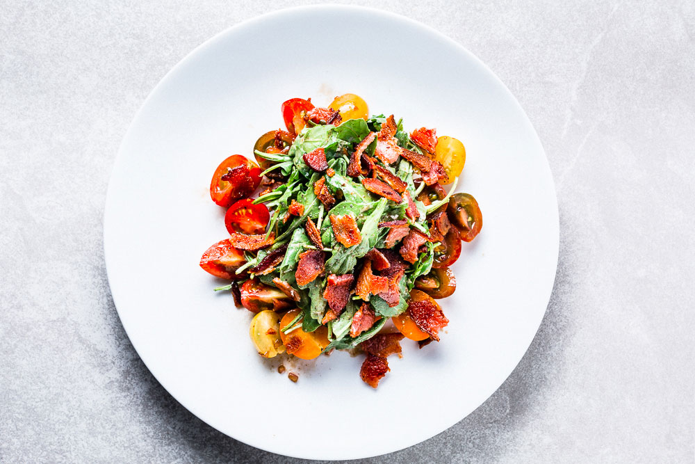 blt salad with baby arugula, heirloom tomatoes and bacon