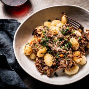 brisket ragu with gnocchi in bowl overhead