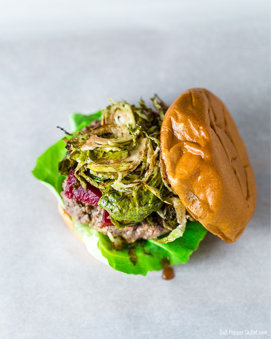 Brussels Sprouts and pickled beets burger on a brioche bun overhead view