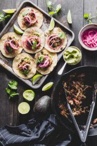 carnitas tacos flatlay vertical