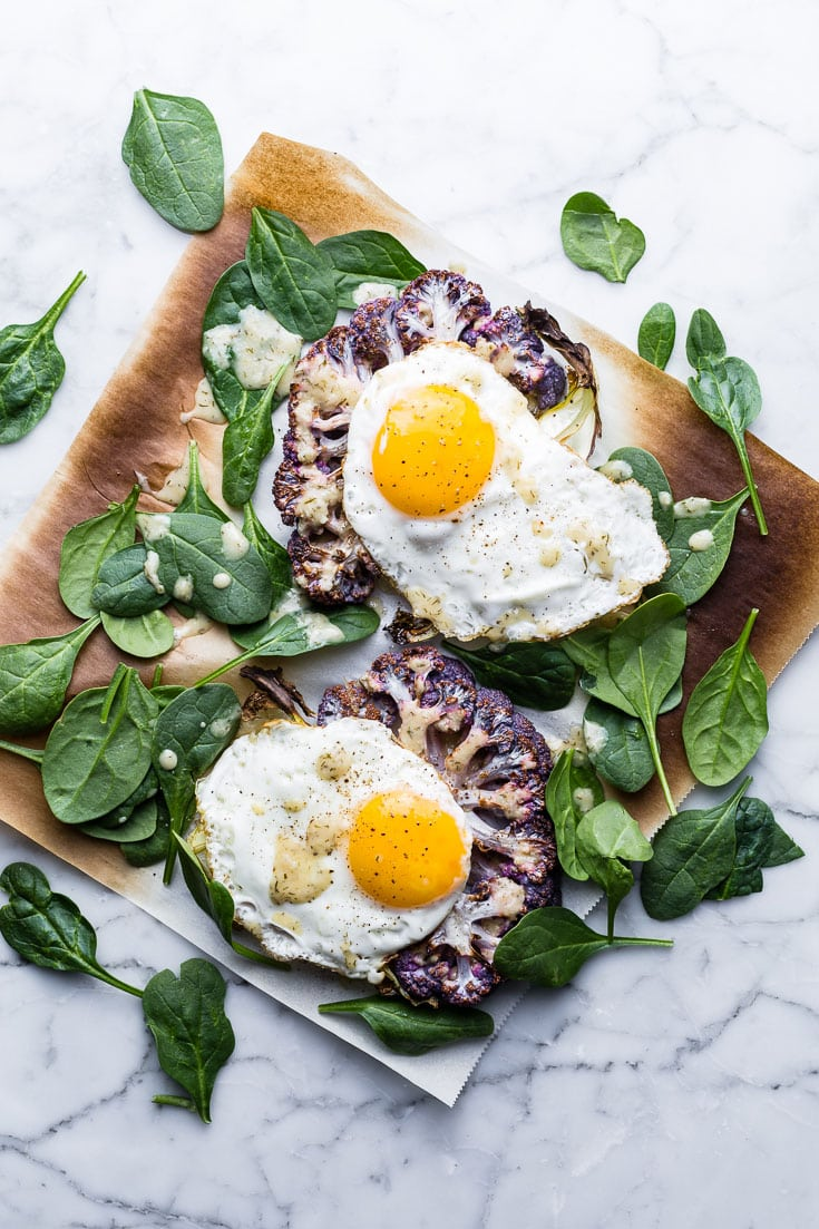 Cauliflower Veggie Toast with Fried Eggs and spinach on marble