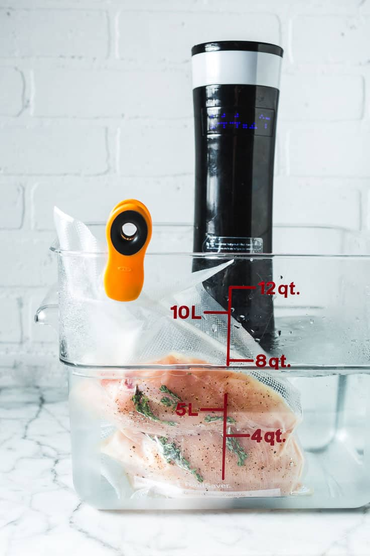 chicken breasts in sous vide water bath
