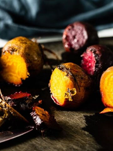 colorful cooked beets on cutting board horizontal