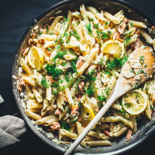 creamy lemon vodka salmon pasta in skillet overhead