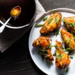 crispy air fryer chicken wings with honey-sriracha sauce