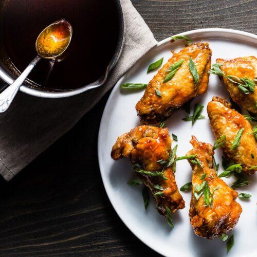crispy air fryer chicken wings with honey-sriracha sauce