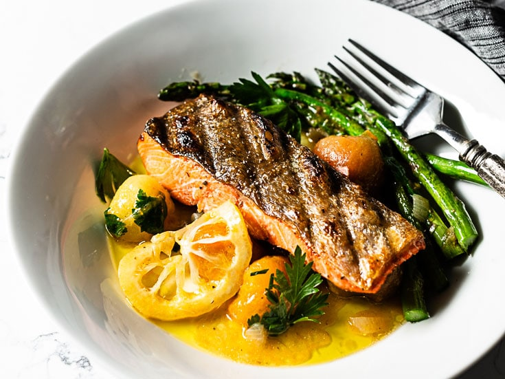 Grilled Salmon Recipe With Crispy Skin And A Burst Cherry Tomato Sauce