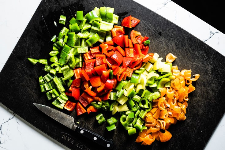 diced colorful chili peppers on cutting board