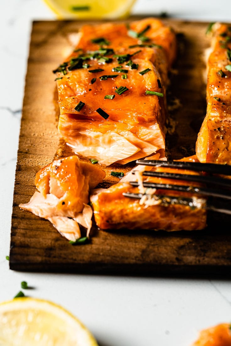 fork with tender and juicy cedar plank salmon
