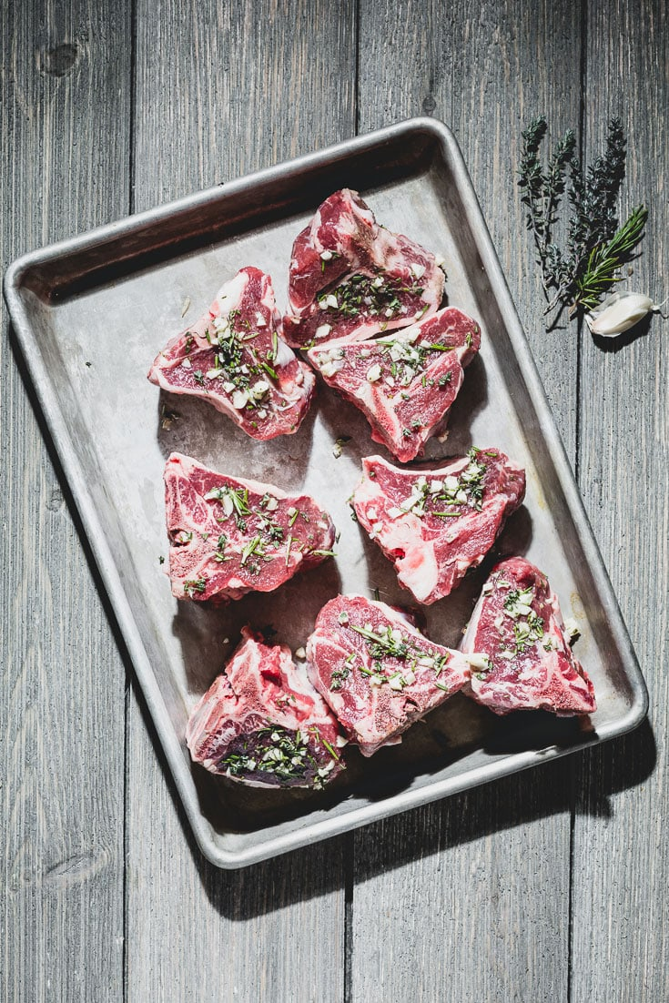 garlic and herb marinated lamb chops on sheet pan