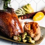 glazed smoked turkey breast on serving plate