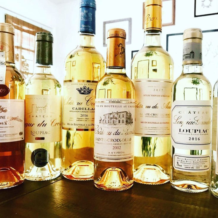 golden bordeaux wine bottles