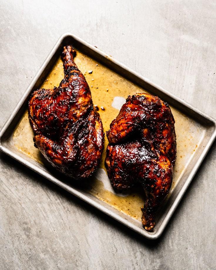 grilled bbq chicken halves on sheet pan