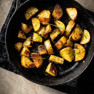 grilled potatoes in skillet vertical