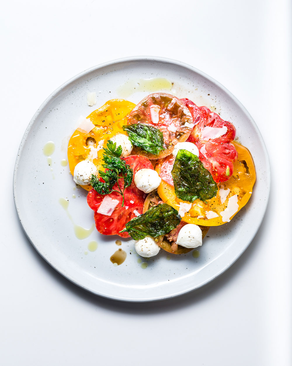 Heirloom Tomato Salad with fresh mozzarella and fried basil