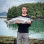 justin mcchesney holding a copper river king salmon
