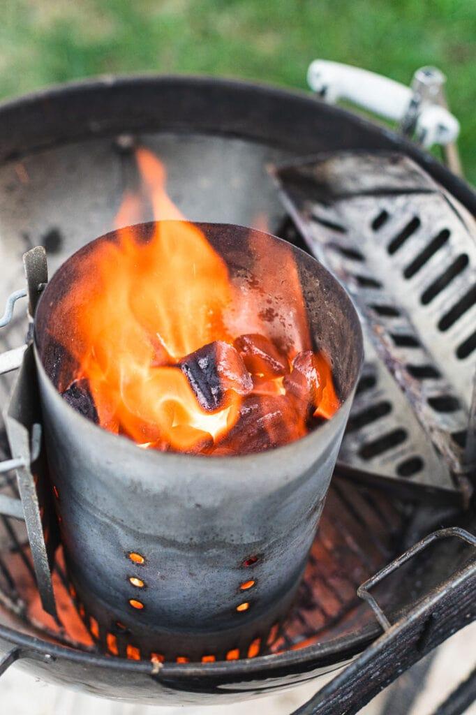 lit Kingsford Charcoal briquets in chimney starter