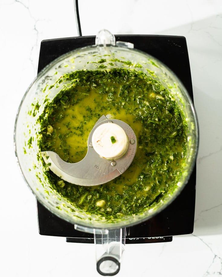 making chimichurri in food processor blended
