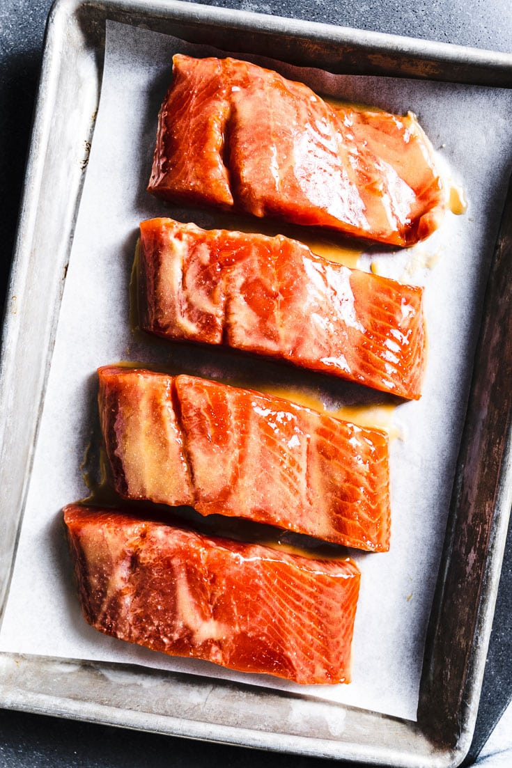 miso salmon filets marinating on sheet pan