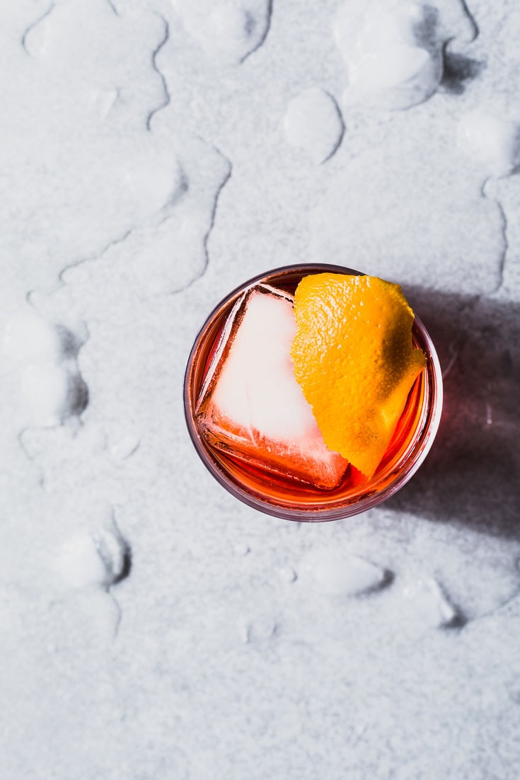 negroni cocktail recipe overhead sourrounded by ice
