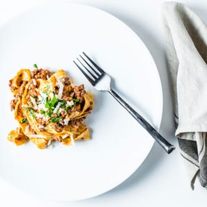 Pasta Bolognese Overhead with fork and napkin