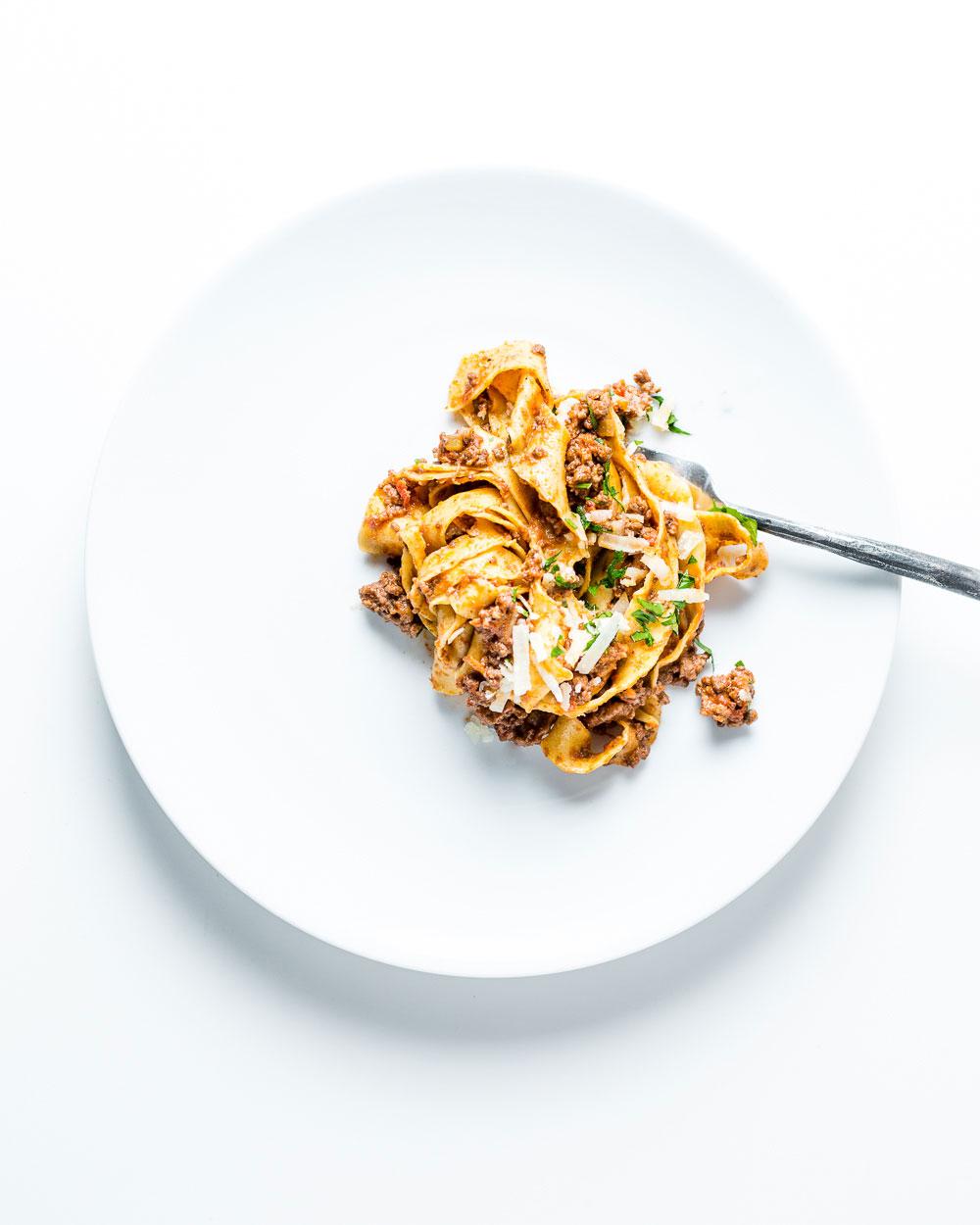 Pasta Bolognese on White Plate Overhead