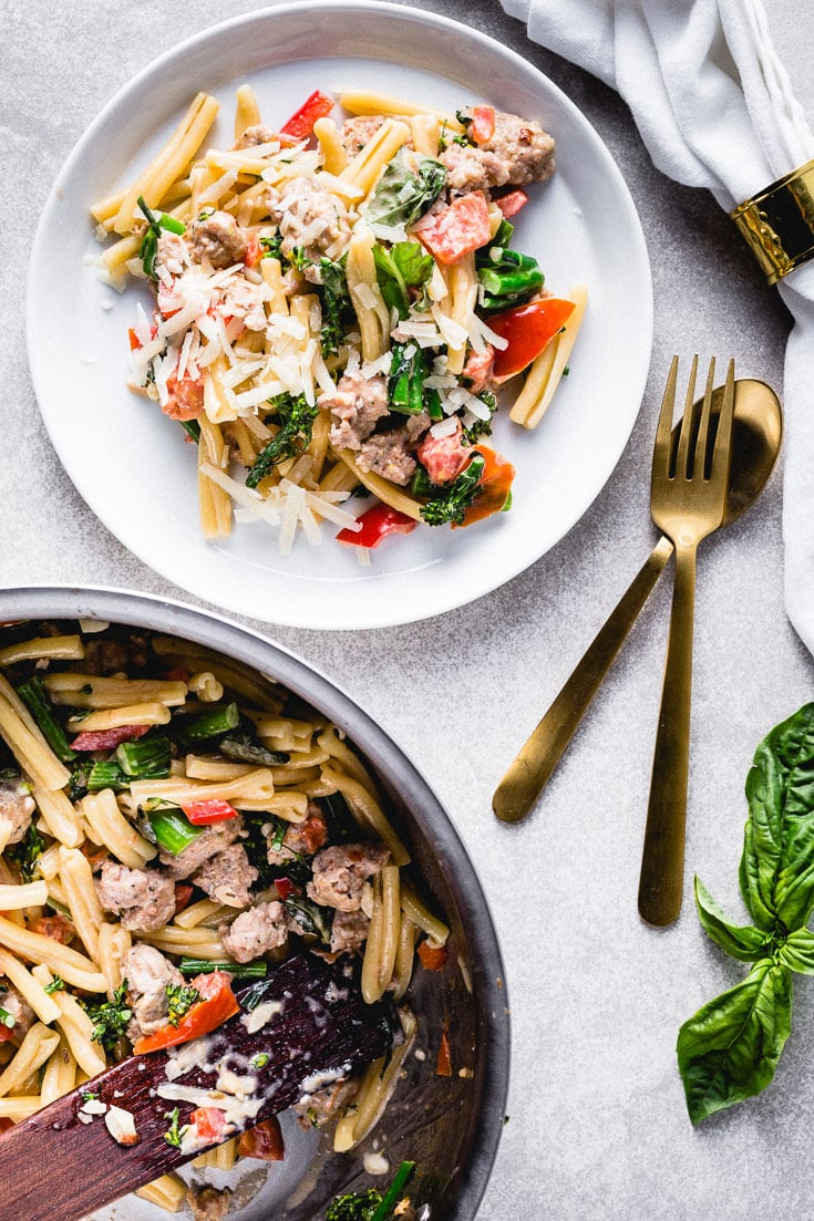 pasta with sausage broccoli and peppers flatlay