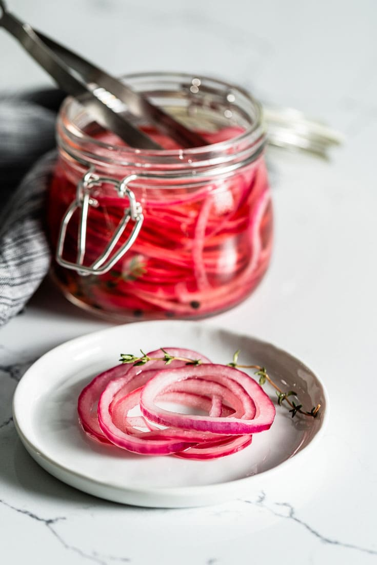 pickled red onions on plate