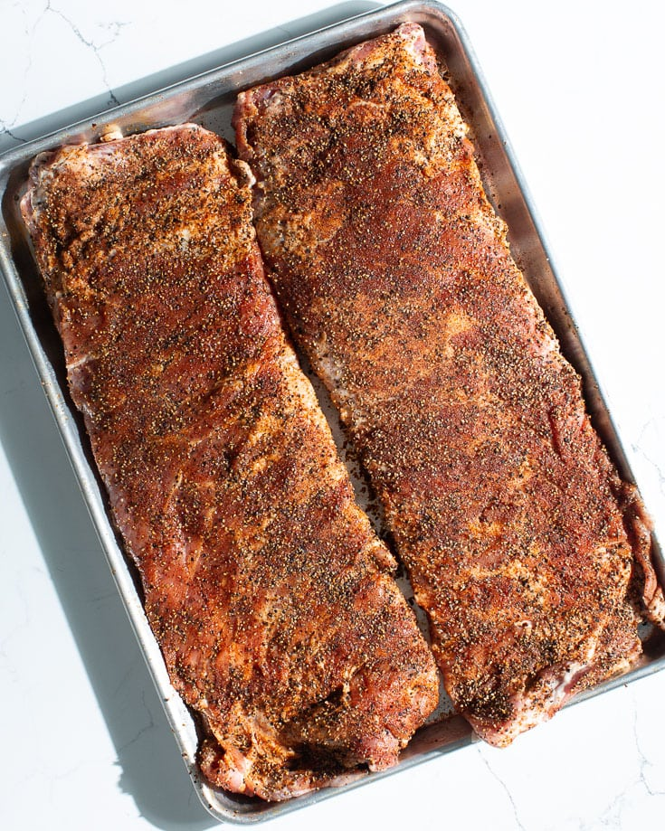 pork spare ribs with rub on sheet pan
