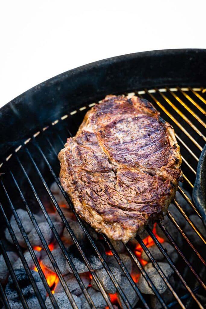 rib eye steak on charcoal grill