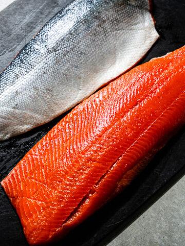 Salmon Filets on Black Cutting Board