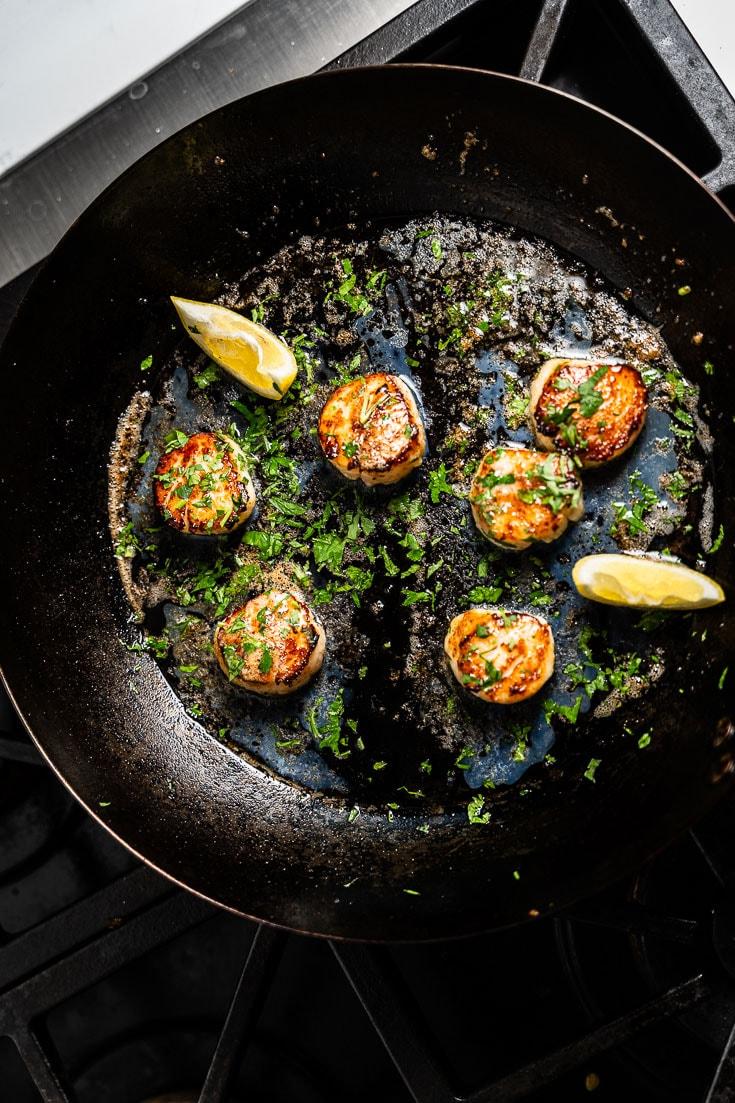 seared scallops in skillet overhead