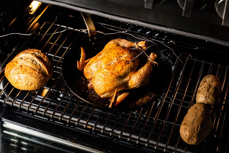 simple roast chicken in oven with bread and potatoes